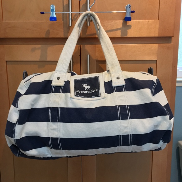 670300b8f6bf Abercrombie   Fitch Handbags - Abercrombie Kids Navy Striped Duffle Bag